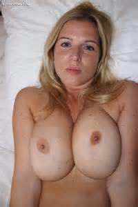 Gorgeous Amateur Blonde Shows Huge Tits In Bed