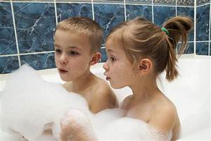 Brother and sister taking a bubble bath little boy and for Girls in bathroom with boys