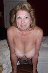 Free photo mature woman braless
