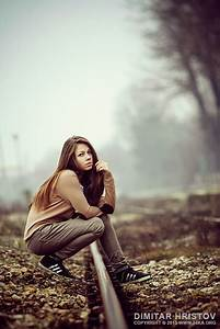 Young Girl Posing On The Train Road In The Mist