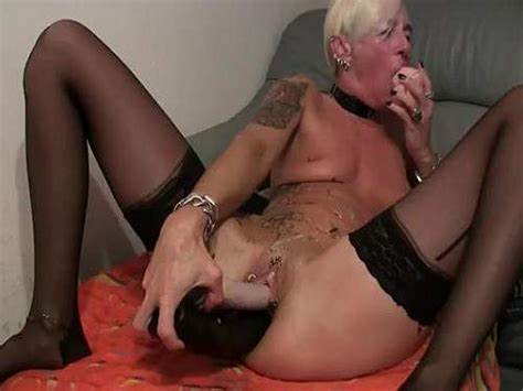 Perverted Granny Pushes Fist Up Her Mature Asshole