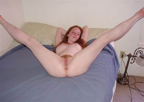 Red Hair Hottie Penetrates Hairy Cunny With Porn Toys
