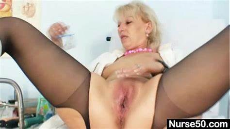 Grey Haired Tranny In Uniform Plays With Her Ginger Hairy Pecker