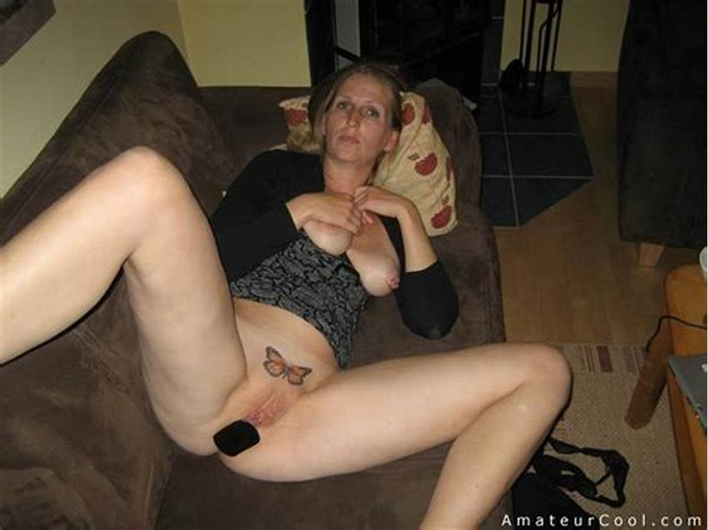 #Shaved #Mature #Wife #Plays #With #Buttplug #On #The #Couch