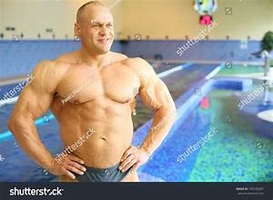 Happy Bodybuilder In Swimming Trunks Looks Away Near Pool Of Gym Hall Stock Photo 194100287