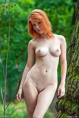 Beautiful naked redhead woman