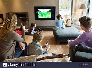Family using electronic gadgets in a living room Stock ...