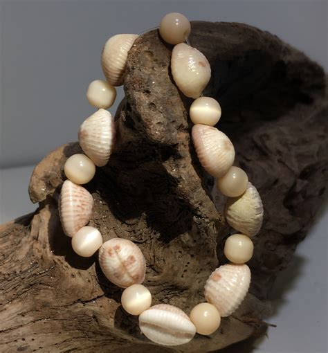 A wide variety of coffee bean shell options are available to you, such as zircon, ruby. Tan Shell Stretch Bracelet - Medium | Stretch bracelets, Orange cat, Unique jewelry