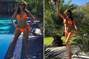 Melanie Sykes, 46, smoulders in orange bikini as she shows ...