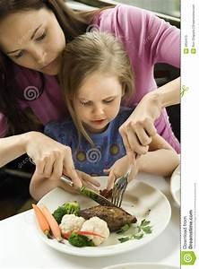 Vertical Family Sign Helping Daughter Cut Food Stock Photos Image 2850473