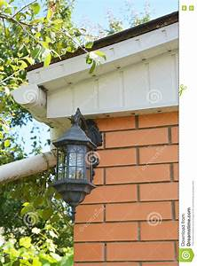 lamp on the wall of the house stock photo cartoondealer With outdoor lighting attached to house