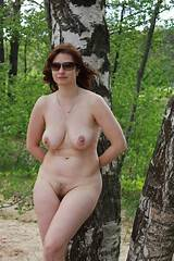 Mature woman nude outdoors