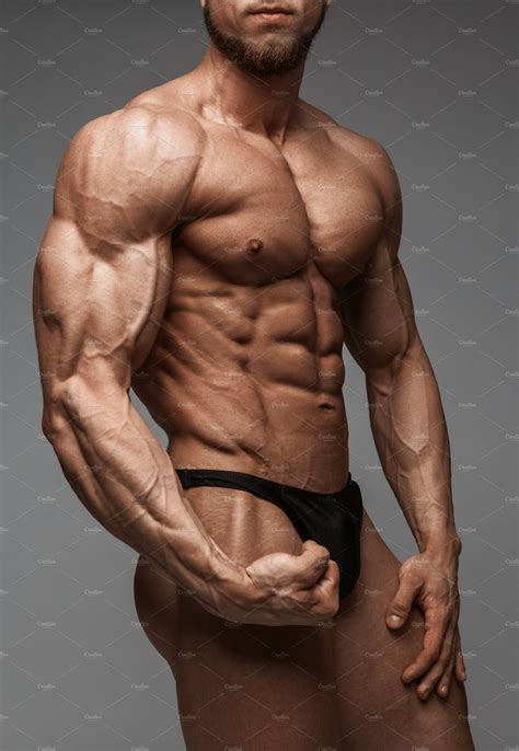 Bodybuilder man with perfect abs | High-Quality Sports Stock Photos ~ Creative Market