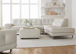 Chic floating shelves with white tufted sectional and for Sectional couch with rug