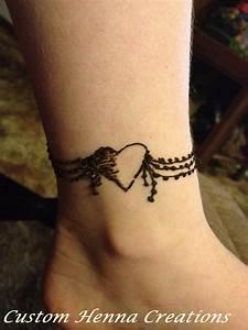 Henna on ankle, mehndi, heart wrap-around design, on child ...